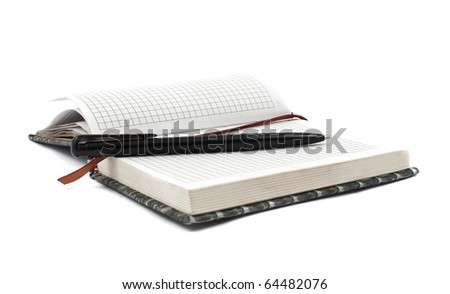 diary with a pen on a white background