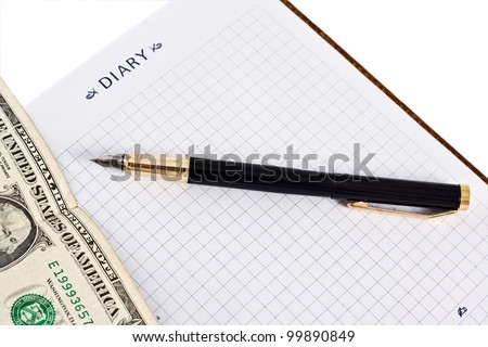 Diary with money and pen isolated on white background