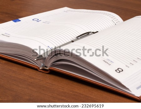 Diary with mortgaged pen on white background, isolated - stock photo