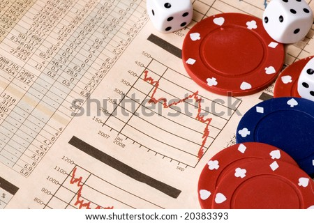 dice and casino chips on a stock market chart - stock photo