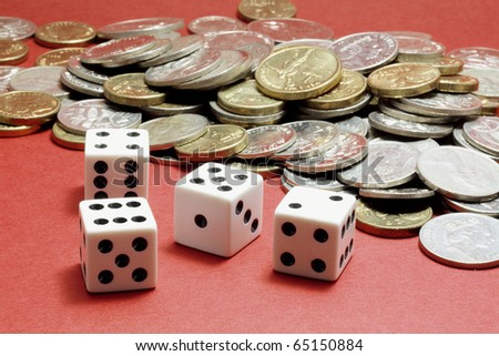 Dice and Coins on Red Background