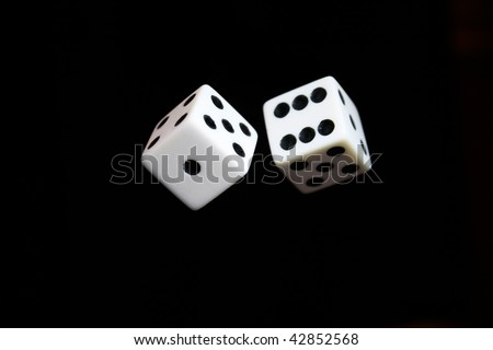 Dice appearing to be thrown in the air - stock photo