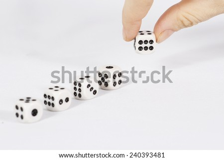 Dice exhibited hands/ Dice on white background - stock photo