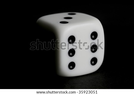 Dice isolated against a black background