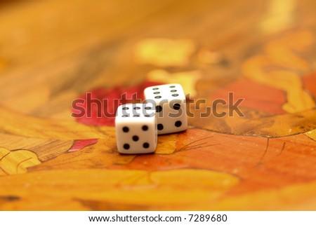 dice on a backgammon board - stock photo