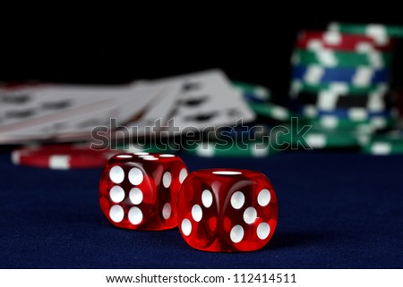 Dice on a blue poker table close-up - stock photo