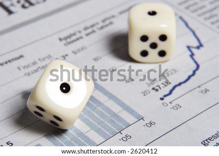 Dice on a graph from a stock report - stock photo