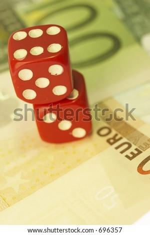 Dice on euro close-up - stock photo
