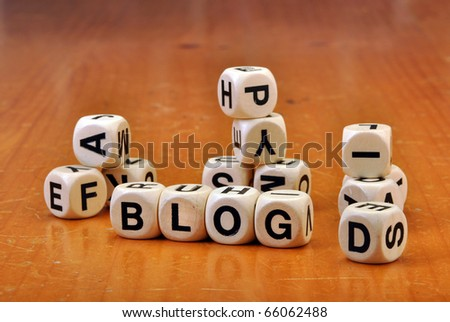 Dice on old vintage table spelling blog - stock photo