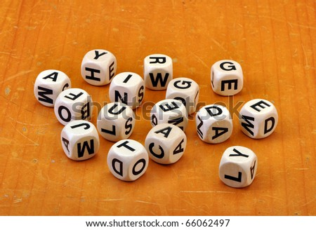 Dice on old vintage table with copy space - stock photo