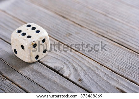 dice on old wood table - stock photo