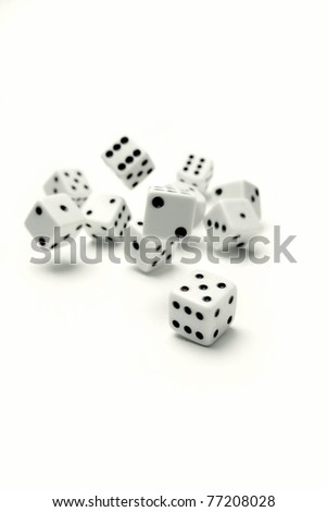 Dice rolling on plain background - stock photo