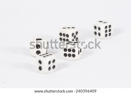 Dice scattered on a white background/ Dice - stock photo