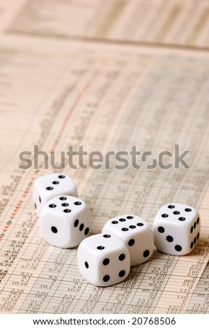 Dice sitting on a stock market chart - stock photo