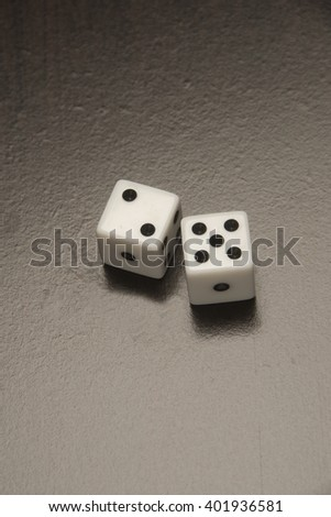 Dice used for gambling/Gambling Dice/Standard gambling dice on a black background - stock photo