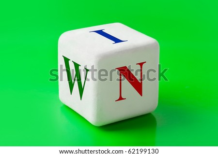 Dice with word Win - concept background - stock photo