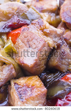 Diced and grilled pork with colorful garnish - stock photo