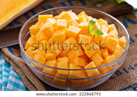 Diced butternut squash in a bowl ready for cooking - stock photo