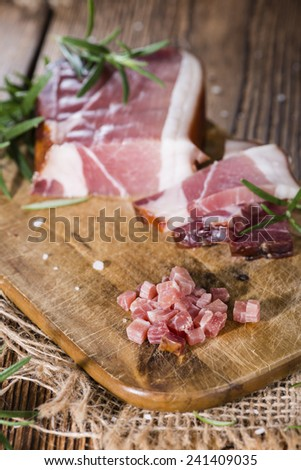 Diced Ham with Rosemary, Salt and pepper on wooden background - stock photo