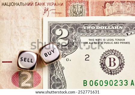 Dices cubes, USD, UAH banknotes. Selective focus - stock photo