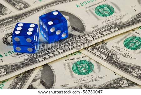 Dices on some money concepts of gambling or taking a risk - stock photo