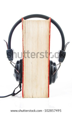 Dictionary and headphone - stock photo