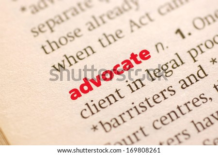 Dictionary definition of advocate. Close up view with paper textures - stock photo