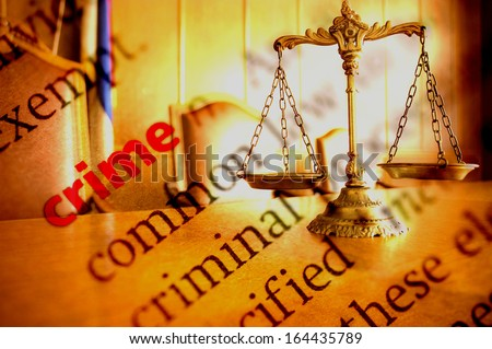 Dictionary definition of crime and Decorative Scales of Justice - stock photo