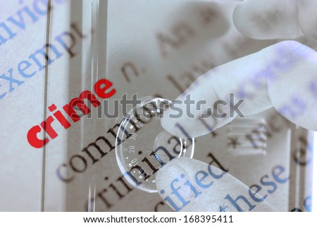 Dictionary definition of crime and hand searching security code of safe - stock photo