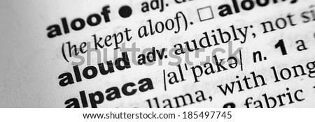 Dictionary definition of the word Aloud - stock photo