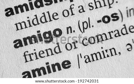 Dictionary definition of the word Amigo - stock photo