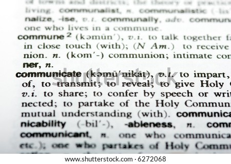Dictionary definition of the word communicate with shallow depth of field