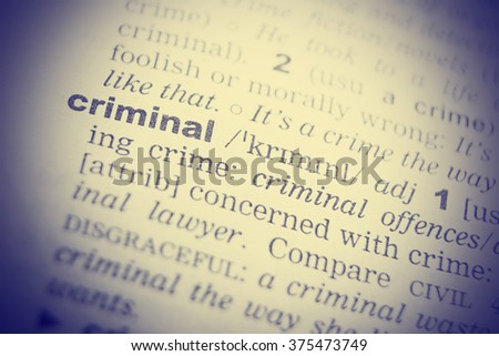 Dictionary definition of the word Criminal in English. Vignetting effect. - stock photo
