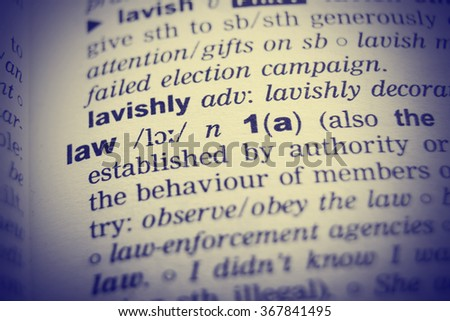 Dictionary definition of the word Law with vignetting effect. - stock photo