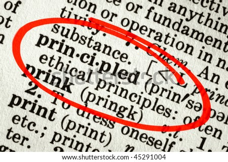 """Dictionary definition of the word """"principled"""", circled in red. - stock photo"""