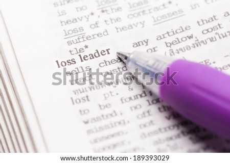 "Dictionary page with word ""loss leader"" in focus."
