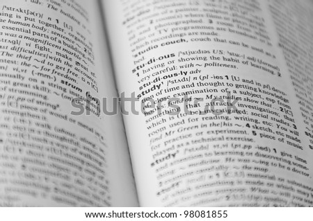 "Dictionary page with word ""study"" in focus and other is defocused - stock photo"