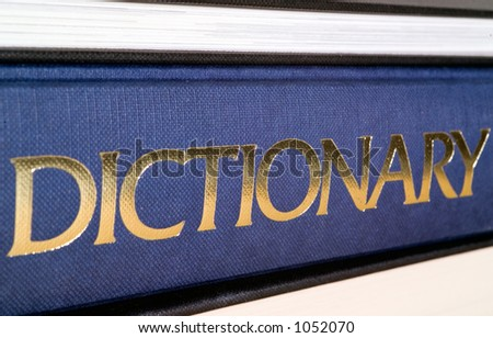 Dictionary spine in gold letters.  Shallow dof. - stock photo