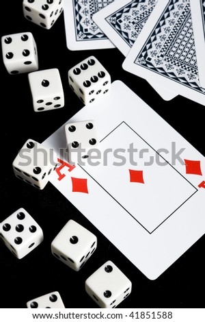 Die and playing card in black background. Game object