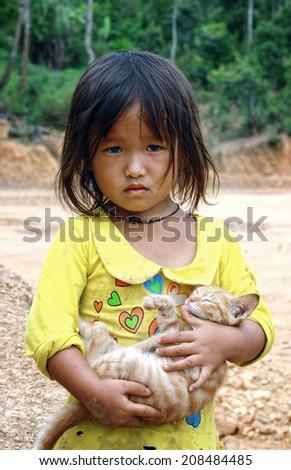 Dien Bien Phu, Dien Bien, Vietnam August 1, 2014: A unidentified Hmong child holding a cat.