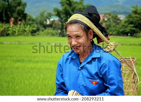Dien Bien Phu, Vietnam July 31, 2014: A woman Lu ethnic cargo by force of the head.