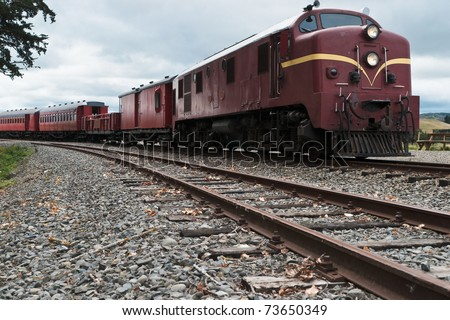Diesal Electric Train with Carriages - stock photo