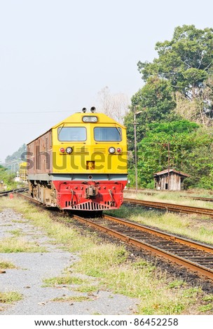 Diesel electric  locomotive in the railway yard of Thai station. - stock photo