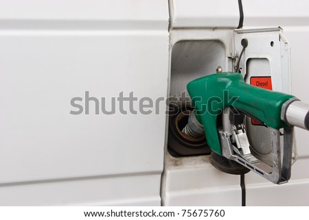 Diesel fuel is use to fill this commercial vehicle. - stock photo