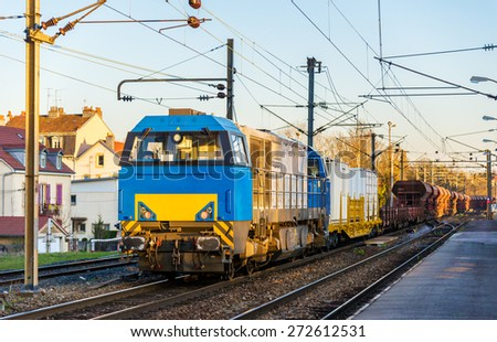Diesel locomotive hauling a freight train at Montbeliard station - France - stock photo