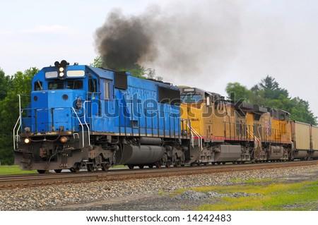 Diesel locomotive spewing a cloud of smoke - stock photo