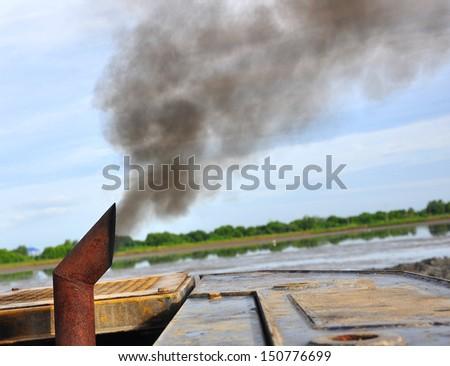 Diesel  spewing a cloud of smoke  - stock photo