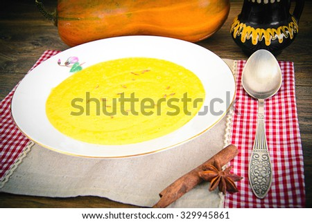 Diet and Healthy Organic Food: Pumpkin Soup. Studio Photo