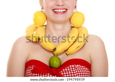 Diet and nutrition. Girl with banana necklace and lemon earrings isolated on white. Young woman recommending fruits. - stock photo