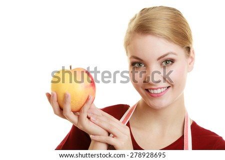 Diet and nutrition. Happy housewife or chef in striped kitchen apron offering red apple healthy fruit isolated